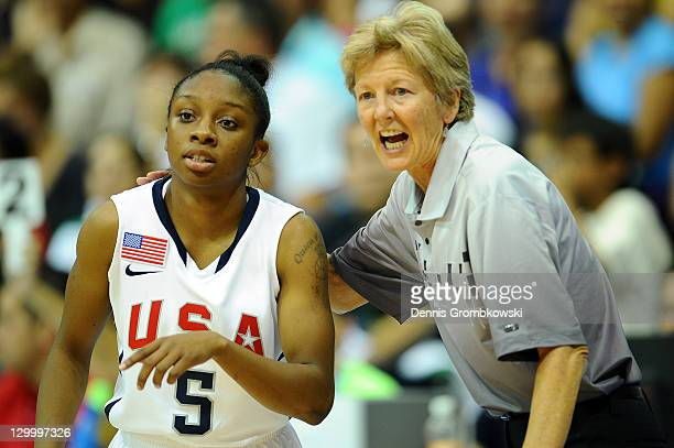 Head coach Adele Cecilia Barry of the USA gives advices to Valencia Treniece McFarland during the Women's Basketball Group A Preliminary match...