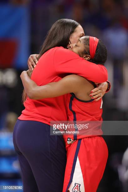 Head coach Adia Barnes of the Arizona Wildcats and Aari McDonald celebrate after defeating the UConn Huskies during the fourth quarter in the Final...