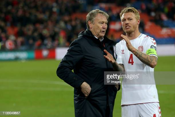 head coach Age Hareide of Denmark and Simon Kjar of Denmark gesture after the 2020 UEFA European Championships group D qualifying match between...