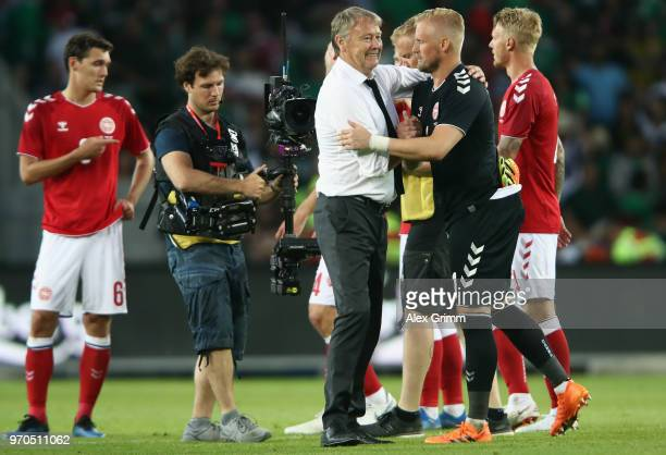 Head coach Age Hareide of Denmark hugs goalkeeper Kasper Schmeichel after the international friendly match between Denmark and Mexico ahead of the...