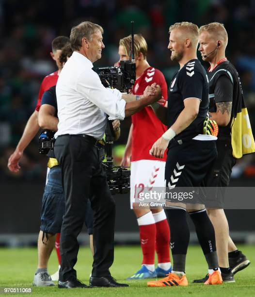 Head coach Age Hareide of Denmark shakes hands with goalkeeper Kasper Schmeichel after the international friendly match between Denmark and Mexico...