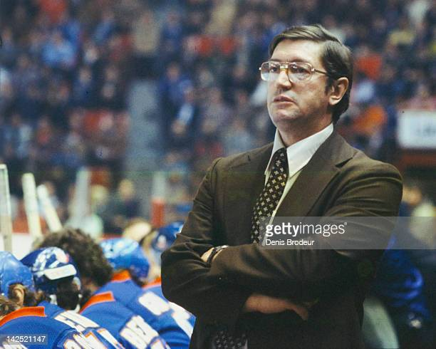 Head Coach Al Arbour of the New York Islanders follows the action from the bench Circa 1970 at the Montreal Forum in Montreal Quebec Canada
