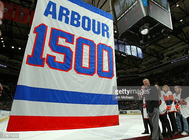 Head coach Al Arbour of the New York Islanders looks on as a banner honoring his 1500 games coached is raised to the rafters after the Islanders...