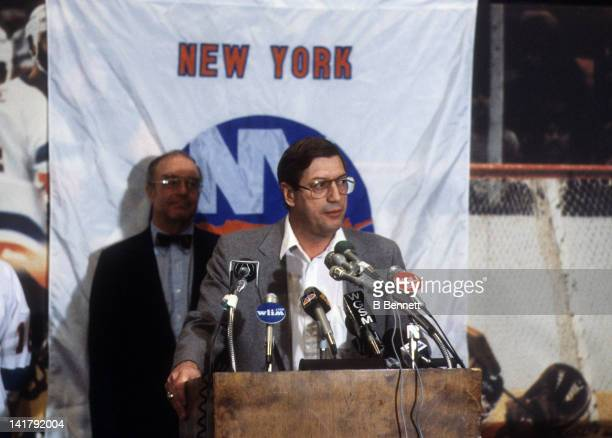 Head coach Al Arbour of the New York Islanders speaks at a press conference as general manager Bill Torrey looks on in March 1984 at the Nassau...