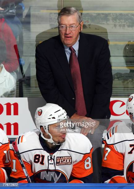Head coach Al Arbour of the New York Islanders stands behind the bench as he coaches his 1500th game for the islanders of the Pittsburgh Penguins on...