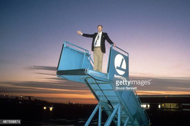 Head coach Al Arbour of the New York Islanders stands on a jet staircase after the New York Islanders won the Stanley Cup against the Vancouver...