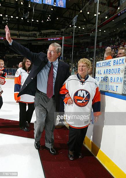 Head coach Al Arbour of the New York Islanders waves to the crowd as he walks off the ice with his wife Claire after defeating the Pittsburgh...