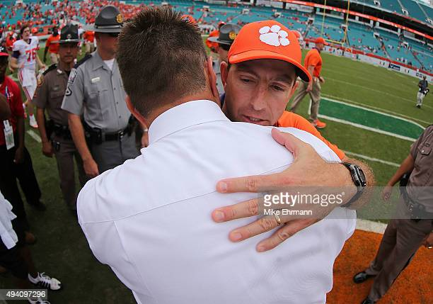 Head coach Al Golden of the Miami Hurricanes and head coach Dabo Swinney of the Clemson Tigers shake hands after a game at Sun Life Stadium on...