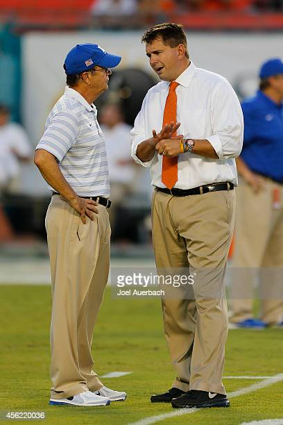 Head coach Al Golden of the Miami Hurricanes and Head coach David Cutcliffe of the Duke Blue Devils meet at midfield prior to the game on September...