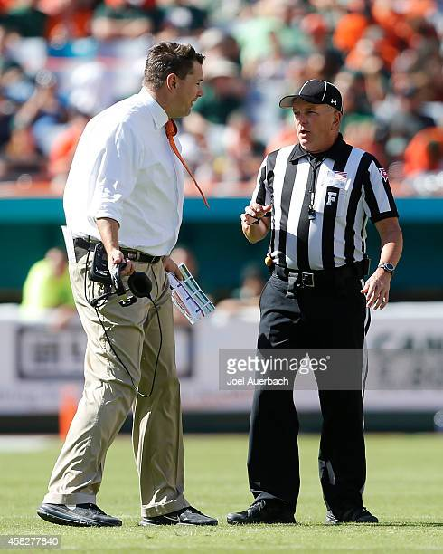 Head coach Al Golden of the Miami Hurricanes argues a call with field judge Bill Dolbow during third quarter action against the North Carolina Tar...