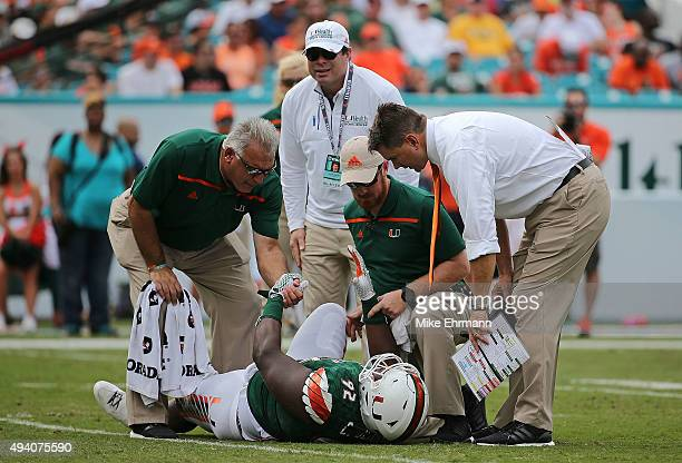 Head coach Al Golden of the Miami Hurricanes checks on Courtel Jenkins during a game against the Clemson Tigers at Sun Life Stadium on October 24,...
