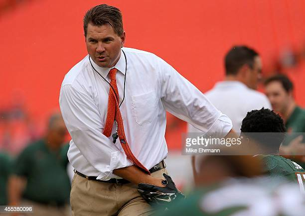 Head coach Al Golden of the Miami Hurricanes greets players during a game against the Arkansas State Red Wolves at Sunlife Stadium on September 13,...