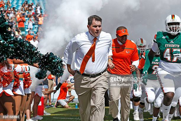 Head coach Al Golden of the Miami Hurricanes leads the players out of the tunnel prior to the game against the Clemson Tigers on October 24, 2015 at...