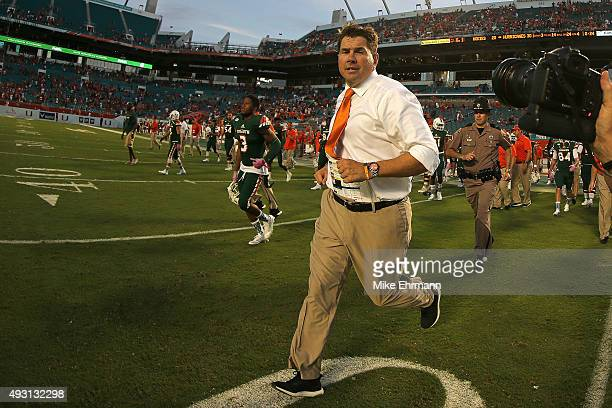 Head coach Al Golden of the Miami Hurricanes runs off the field following a game against the Virginia Tech Hokies at Sun Life Stadium on October 17,...