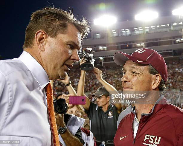 Head Coach Al Golden of the Miami Hurricanes talk with Head Coach Jimbo Fisher of the Florida State Seminoles before the game at Doak Campbell...