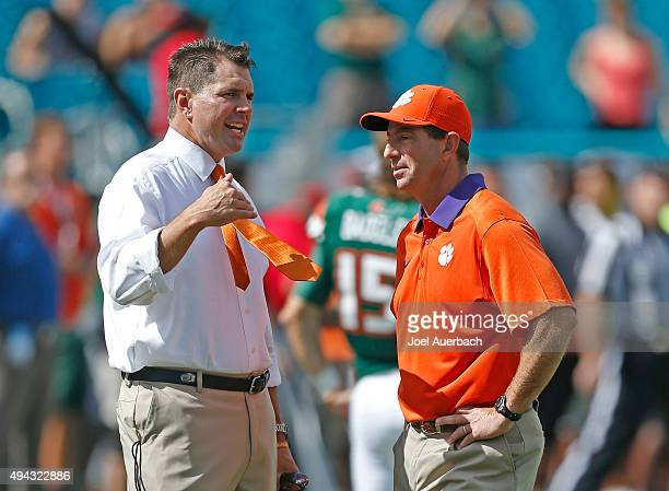Head coach Al Golden of the Miami Hurricanes talks to head coach Dabo Swinney of the Clemson Tigers prior to their game on October 24, 2015 at Sun...