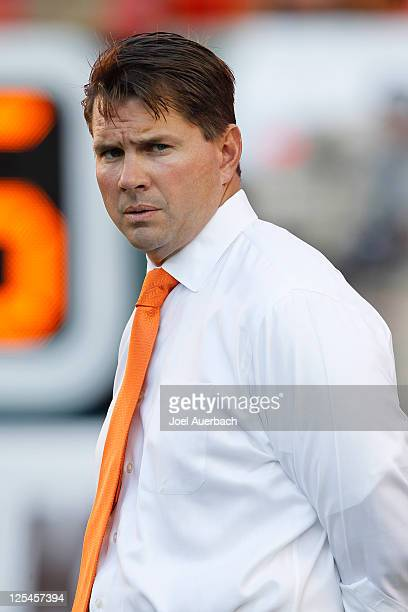 Head Coach Al Golden of the Miami Hurricanes watches the team warm up prior to the game against the Ohio State Buckeyes on September 17 2011 at Sun...