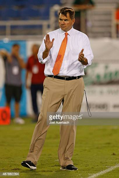 Head coach Al Golden of the Miami Hurricanes watches the team warm up prior to their game against the Florida Atlantic Owls on September 11, 2015 at...