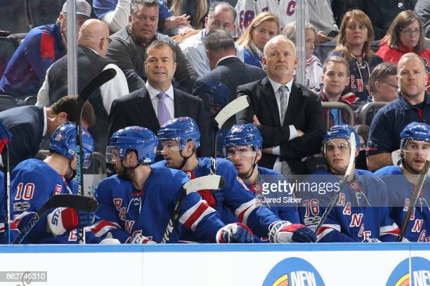 Head coach Alain Vigneault and assistant coach Lindy Ruff of the New York Rangers watch the action from the bench during the game against the New...