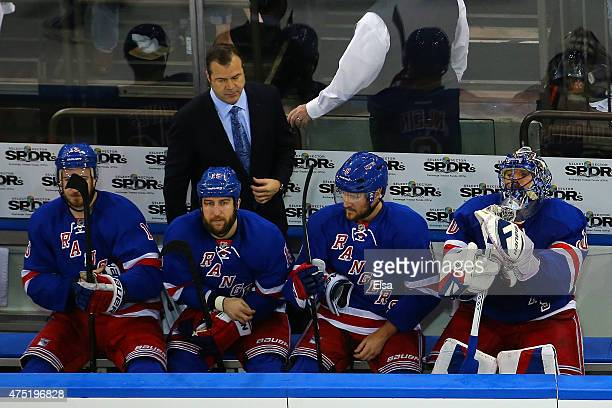 Head coach Alain Vigneault and Henrik Lundqvist of the New York Rangers look on from the bench late in the third period against the Tampa Bay...