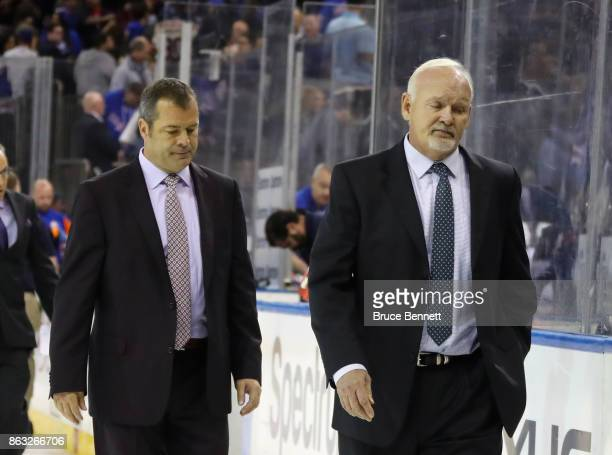 Head coach Alain Vigneault of the New York Rangers and assistant coach Lindy Ruff leave the ice following a 43 shootout loss to the New York...