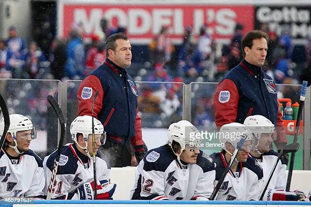 Head coach Alain Vigneault of the New York Rangers looks on against the New Jersey Devils during the 2014 Coors Light NHL Stadium Series at Yankee...