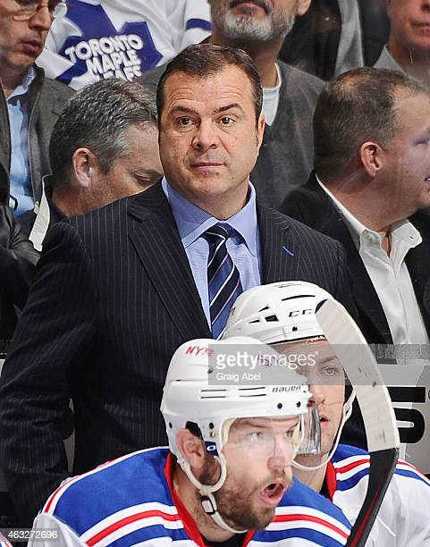 Head Coach Alain Vigneault of the New York Rangers looks on from the bench during NHL game action against the Toronto Maple Leafs at the Air Canada...