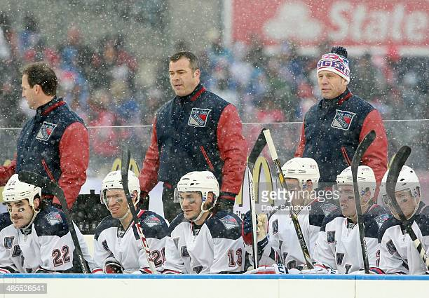 Head Coach Alain Vigneault of the New York Rangers looks on from the bench area in the second period during the 2014 Coors Light NHL Stadium Series...