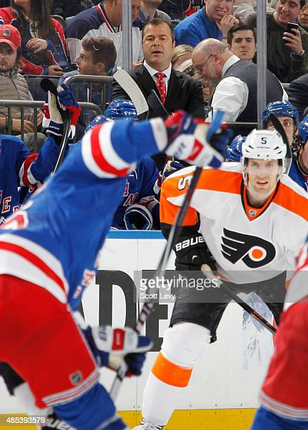 Head coach Alain Vigneault of the New York Rangers looks on from the bench against the Philadelphia Flyers in Game One of the First Round of the 2014...