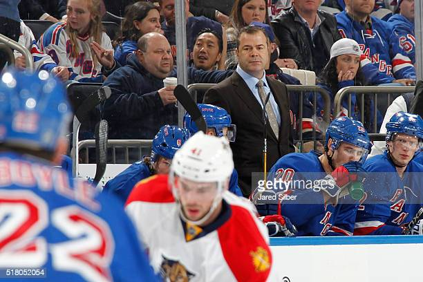 Head coach Alain Vigneault of the New York Rangers looks on from the bench during the game against the Florida Panthers at Madison Square Garden on...