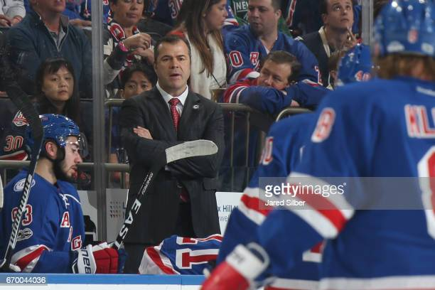 Head coach Alain Vigneault of the New York Rangers looks on from the bench against the Montreal Canadiens in Game Three of the Eastern Conference...