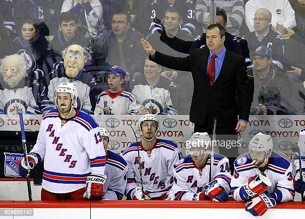 Head Coach Alain Vigneault of the New York Rangers signals from the bench during second period action against the Winnipeg Jets at the MTS Centre on...