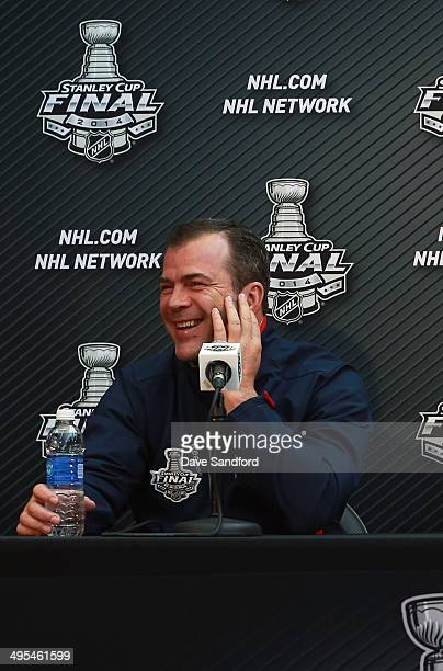 Head Coach Alain Vigneault of the New York Rangers speaks with reporters during Media Day for the 2014 Stanley Cup Final at Staples Center on June 3...