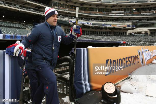 Head Coach Alain Vigneault of the New York Rangers takes the ice during practice for the 2018 Bridgestone NHL Winter Classic at Citi Field on...