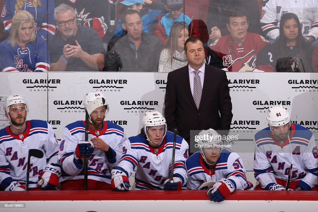 Head coach Alain Vigneault of the New York Rangers watches from the bench during the first period of the NHL game against the Arizona Coyotes at Gila River Arena on January 6, 2018 in Glendale, Arizona.