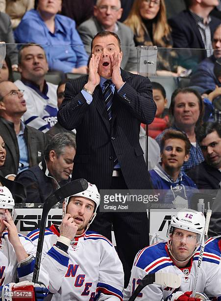 Head Coach Alain Vigneault of the New York Rangers yells from the bench during NHL game action against the Toronto Maple Leafs February 10 2015 at...