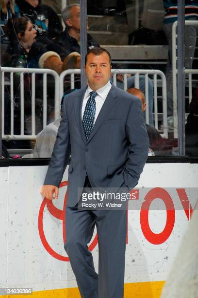Head coach Alain Vigneault of the Vancouver Canucks enters for the 2nd period against the San Jose Sharks at the HP Pavilion on November 26 2011 in...