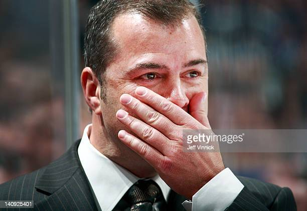 Head coach Alain Vigneault of the Vancouver Canucks looks on from the bench during their NHL game against the St Louis Blues at Rogers Arena March 1...