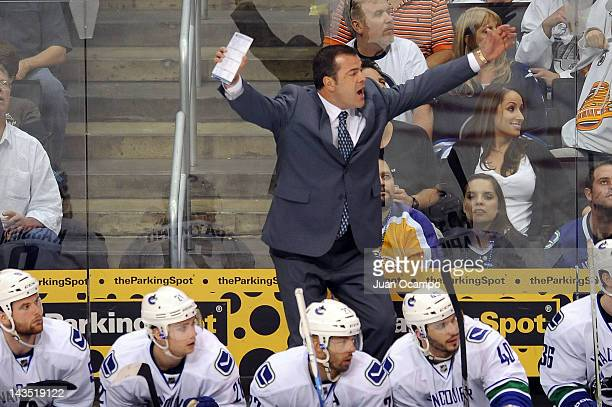 Head Coach Alain Vigneault of the Vancouver Canucks stands on the bench during the game against the Los Angeles Kings in Game Four of the Western...