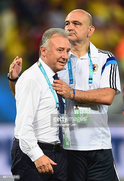 Head coach Alberto Zaccheroni and assistant coach Eugenio Albarella react after the 2014 FIFA World Cup Brazil Group C match between Japan and...