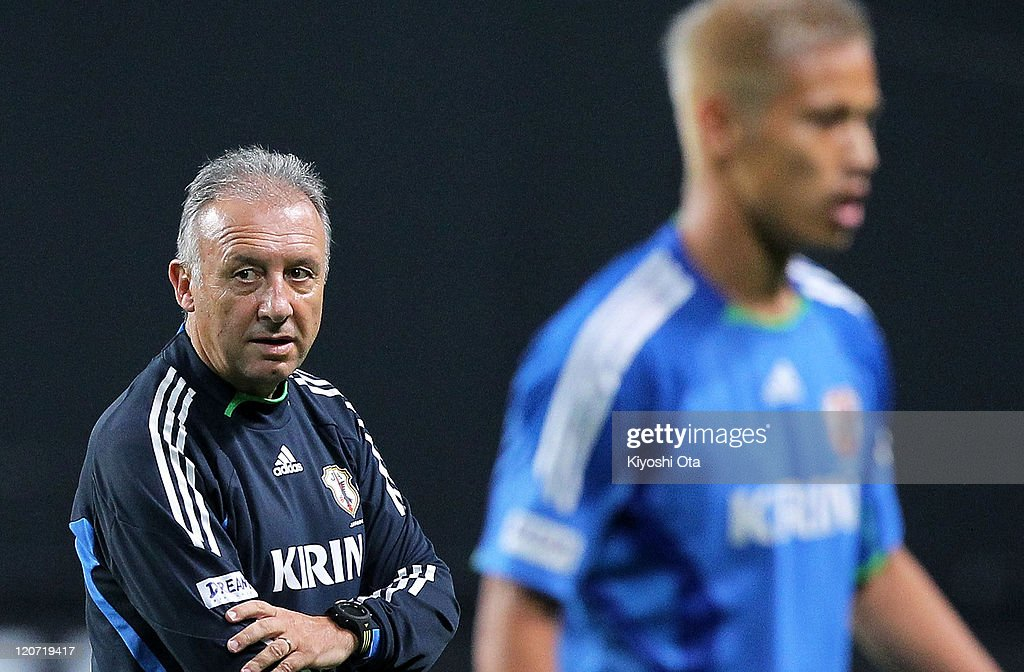 Head coach Alberto Zaccheroni (L) looks on during the Japan national team training session ahead of the Kirin Challenge Cup international friendly match against South Korea at Sapporo Dome on August 9, 2011 in Sapporo, Japan.
