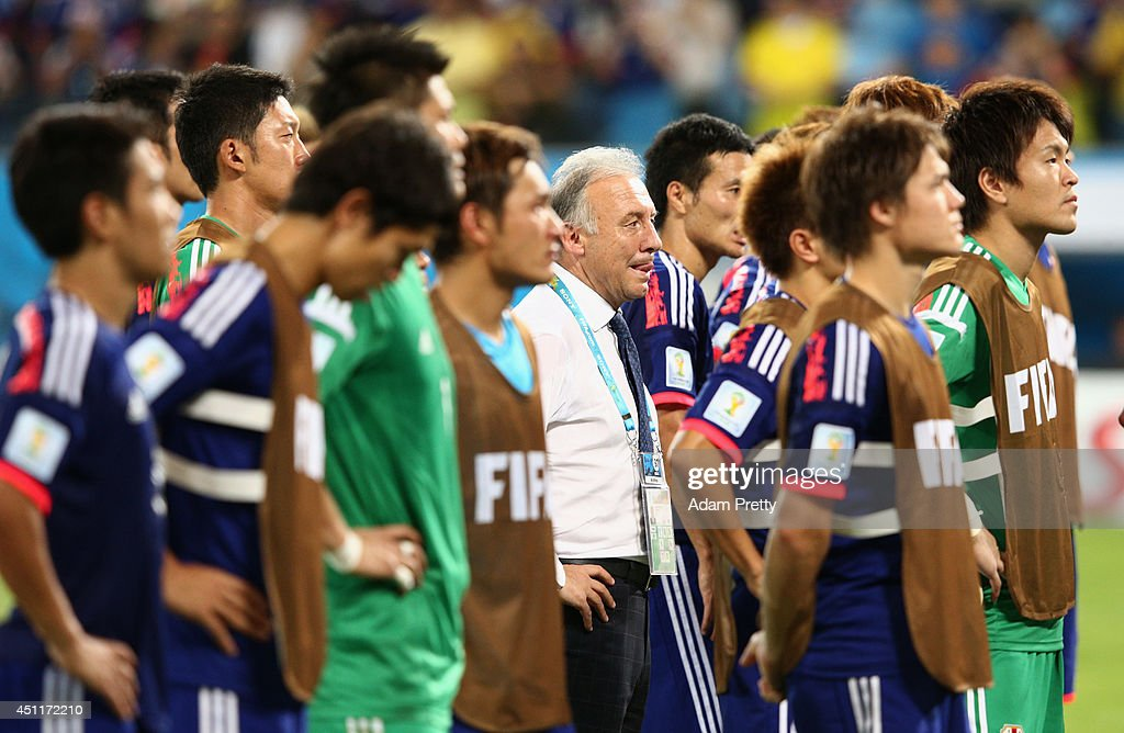 Head coach Alberto Zaccheroni of Japan and his players look on after a 4-1 defeat to Colombia in the 2014 FIFA World Cup Brazil Group C match between Japan and Colombia at Arena Pantanal on June 24, 2014 in Cuiaba, Brazil.