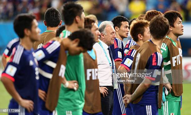 Head coach Alberto Zaccheroni of Japan and his players look on after a 41 defeat to Colombia in the 2014 FIFA World Cup Brazil Group C match between...