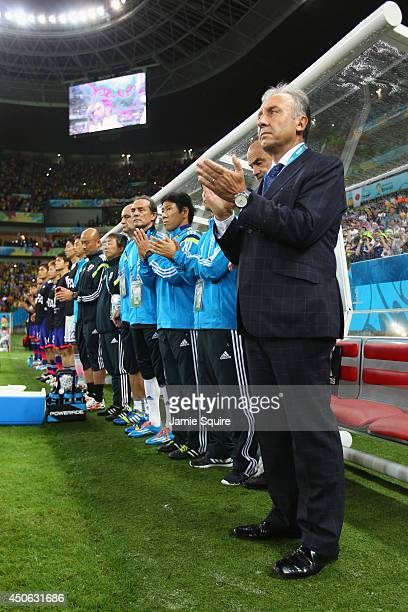 Head coach Alberto Zaccheroni of Japan looks on with his team during the 2014 FIFA World Cup Brazil Group C match between the Ivory Coast and Japan...
