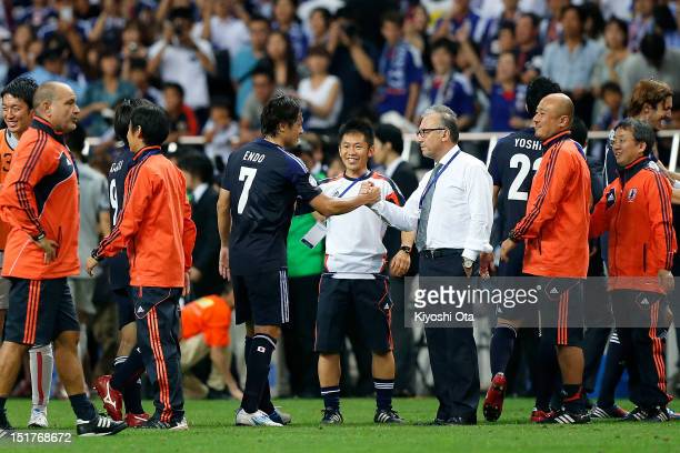 Head coach Alberto Zaccheroni of Japan shakes hands with Yasuhito Endo of Japan after winning the FIFA World Cup final qualifier match against Iraq...