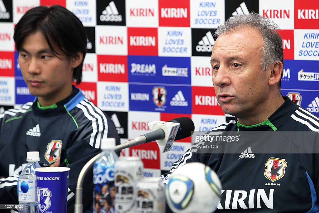 Head coach Alberto Zaccheroni (R) speaks with his interpreter Daisuke Yano during a press conference following the Japan national team training session ahead of the Kirin Challenge Cup international friendly match against South Korea at Sapporo Dome on August 9, 2011 in Sapporo, Japan.