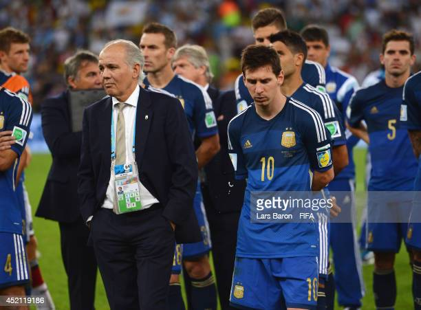 Head coach Alejandro Sabella and Lionel Messi of Argentina show their dejection after the 01 defeat in the 2014 FIFA World Cup Brazil Final match...