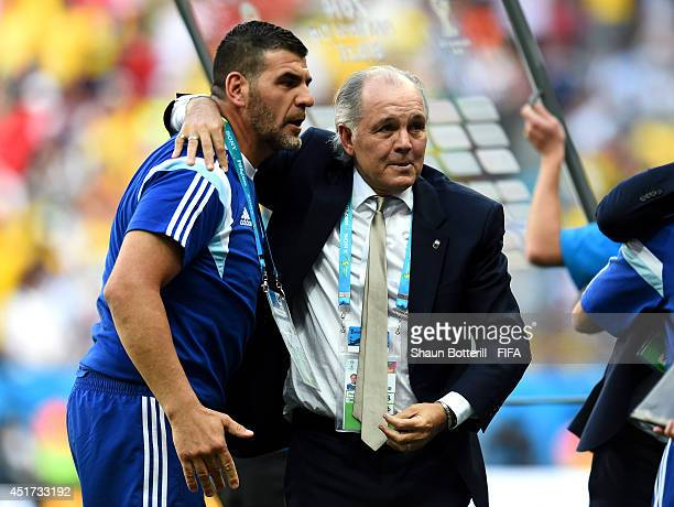Head coach Alejandro Sabella of Argentina celebrates the 10 win after the 2014 FIFA World Cup Brazil Quarter Final match between Argentina and...