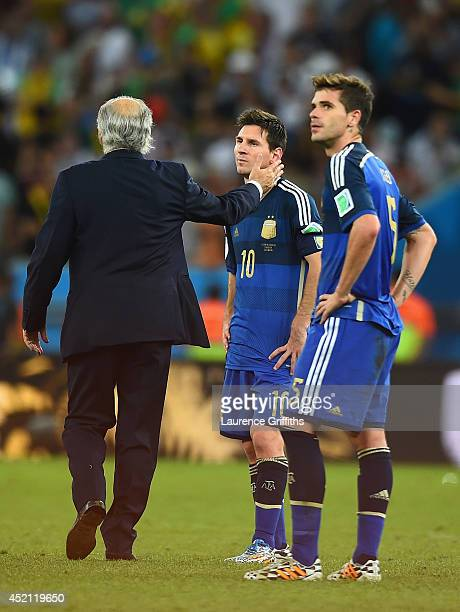 Head coach Alejandro Sabella of Argentina consoles Lionel Messi after being defeated by Germany 10 in extra time during the 2014 FIFA World Cup...