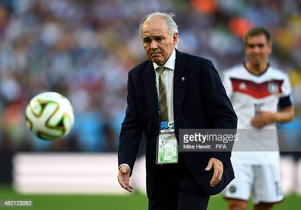 Head coach Alejandro Sabella of Argentina gathers the ball during the 2014 FIFA World Cup Brazil Final match between Germany and Argentina at...